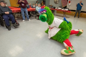 The Phillie Phanatic faces off a stand-in for the Detroit Tigers at the New Jersey Veterans Memorial Home at Vineland, N.J., April 11, 2018