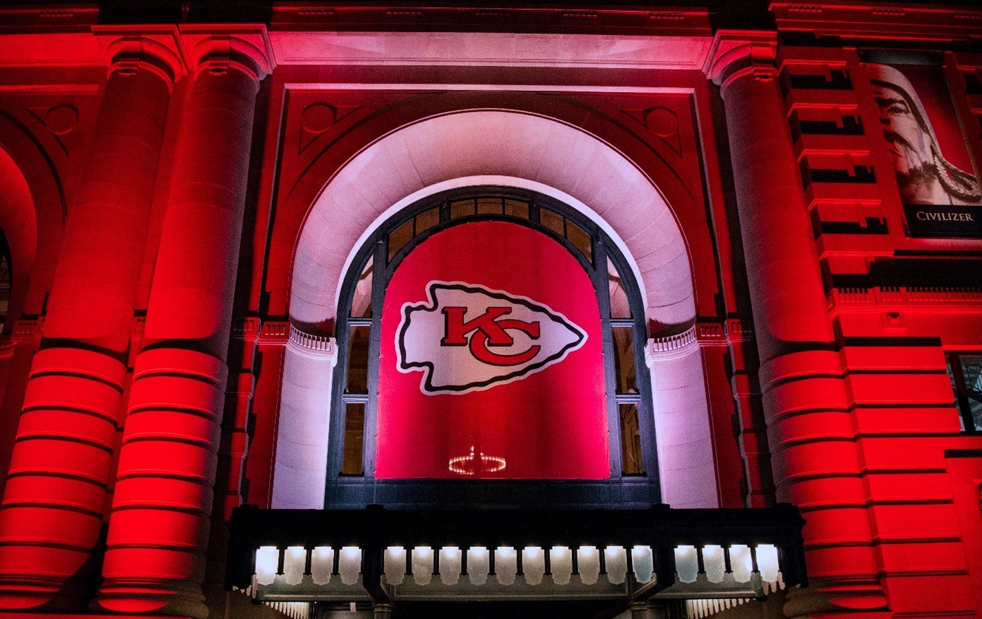 Kansas City Chiefs Red Banner lit up on display on the side of a building