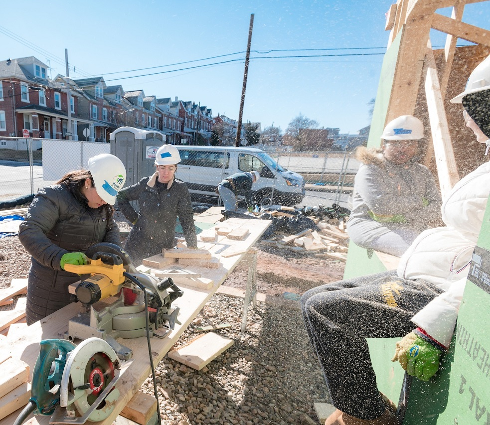 Volunteers work with Habitat for Humanity building homes
