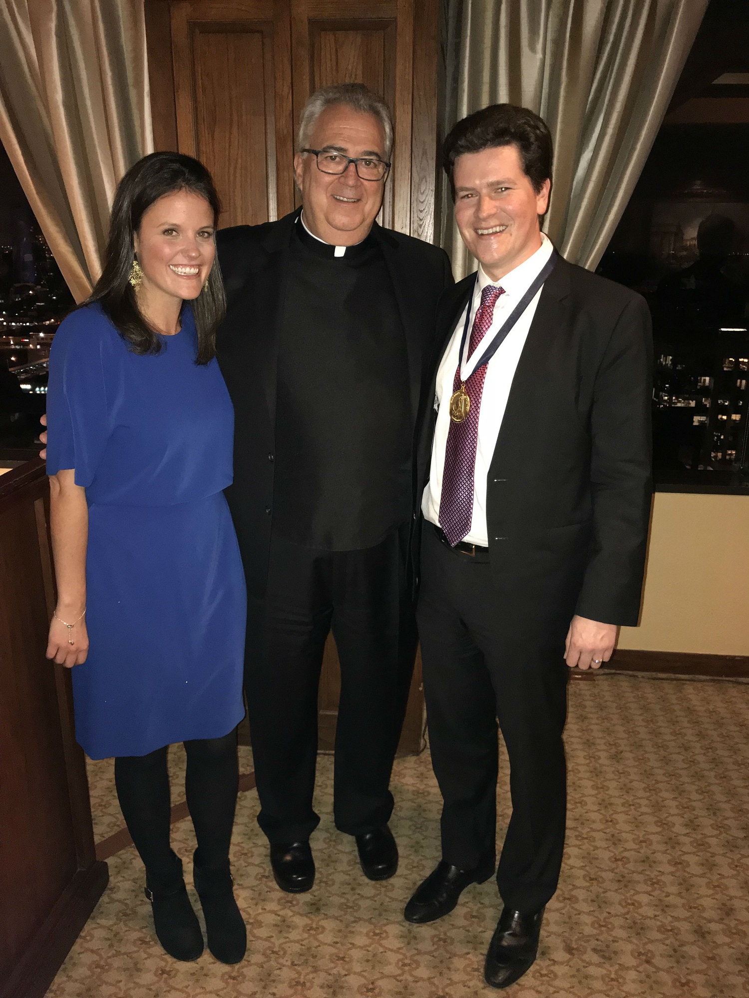 Kevin Curley '09 and his wife, Courtney '09, with Villanova University President the Rev. Peter M. Donohue, OSA, PhD