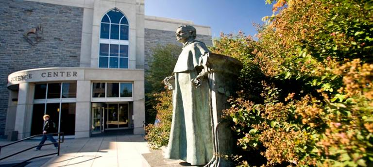 image showing the Mendel statue and Mendel Science Center on Villanova campus