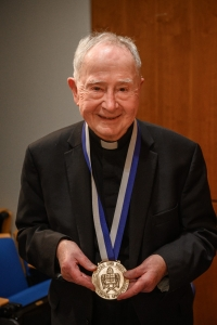 John W. O'Malley, SJ, PhD, wearing medal