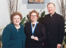 College of Nursing 50th Anniversary Medallion recipient Dr. Donna Zimmaro Bliss, BSN '81 with Dean Fitzpatrick and University President Rev. Edmund J. Dobbin, OSA. April 26, 2004.