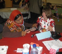 Samiha Al Habsi checks the blood pressure of Pastor Dawn Taylor of St. Matthew's Church