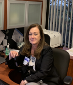 Nurse executive sitting at her work desk.