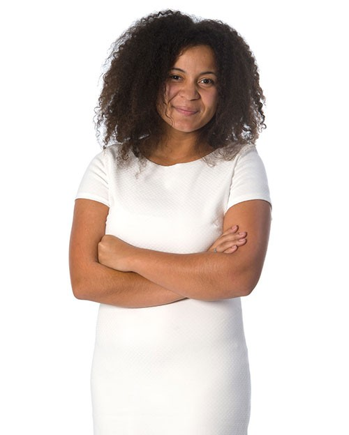 Madiah Gant, a young African American woman with shoulder length curly black hair, wearing a white dress