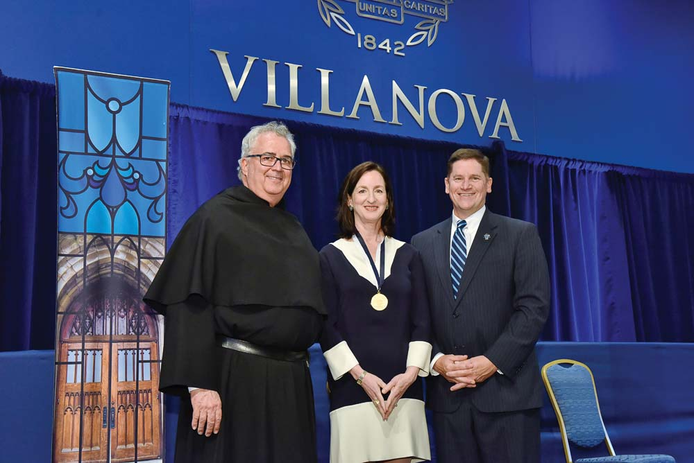 Father Peter stands with St. Thomas of Villanova Alumni Medal recipient Catherine Keating '84 CLAS; and George Kolb '84 VSB, associate vice president, Alumni Relations