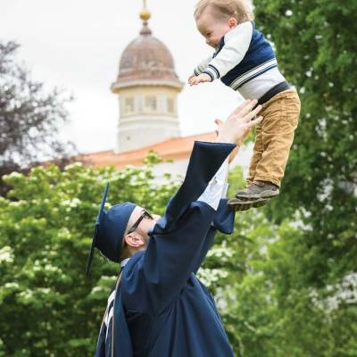 Graduate tosses baby into the air