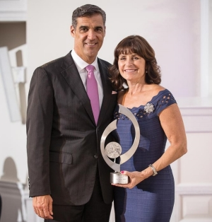 Patti and Jay Wright pose with their award