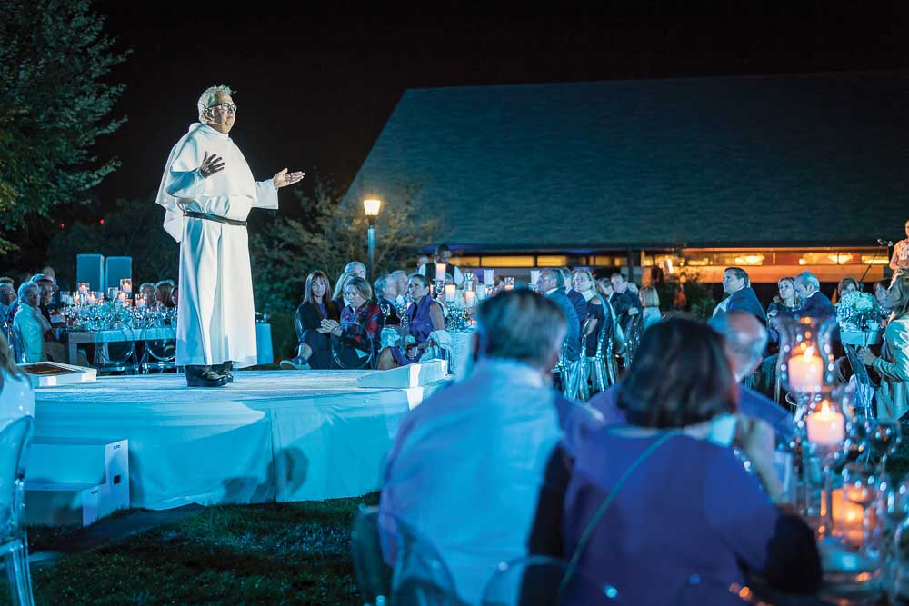 Father Peter presides over outdoor mass and dinner