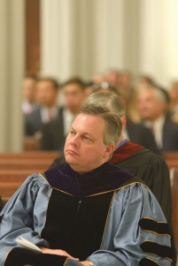 Michael Moreland in graudation robes