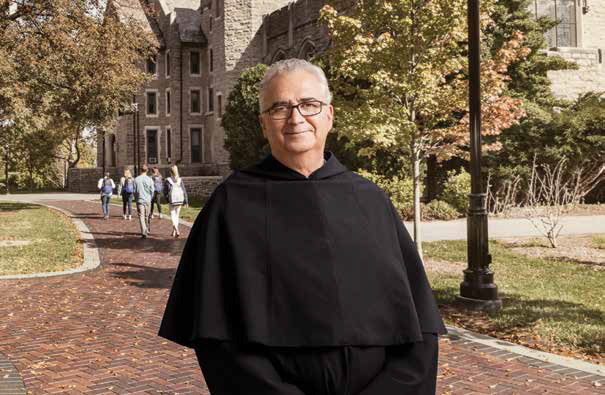 Father Peter Donahue smiling on campus