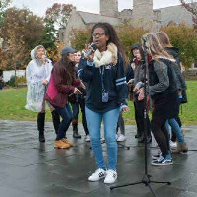 An a capella group performs at Riley Ellipse