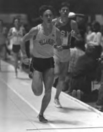 Black and white photo of Marcus O'Sullivan '84 VSB, '89 MBA running track