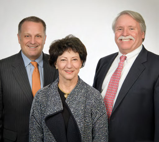 3 new trustees smiling, two males, one female