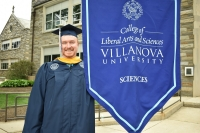Master's student in Biology carries convocation banner