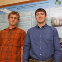 Graduate students Justin Yeash '09 (left) and Adam Hoffman '09, who received Honorable Mention at the poster presentation