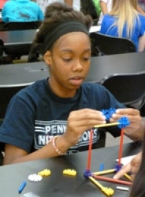 Participants applied lessons learned in class to hands-on activities, such as building truss bridges with Knex.