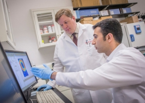 Dr. Jens Karlsson with a member of his Villanova research team.