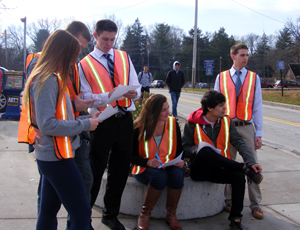 Rachel Antonio, James Matzke, Robert Flynn, Diana Chiavetta, Dylan White, and Evan Campbell conduct traffic counts at an intersection