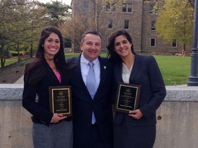 Laura Boisclair, winner of the Inaugural Chairman's Award, and Raquel Burlotos, recipient of the Lewis J. Mathers Award, pose with Professor and Department Chair David Dinehart, PhD.