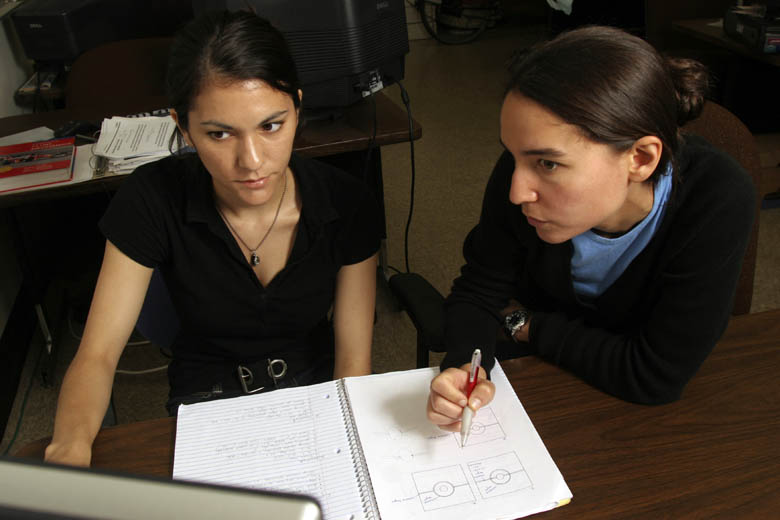 Dr. Ani Ural (right) explains a concept to one of her Mechanical Engineering students.