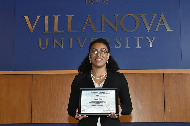 "Deyjah Foster '19 ChE accepted the Halloran Social Venture award for the ""Afya Tea"" team."