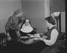 Two RN completion students with Sr. Alma Lawler, RSM, Co-Director, College of Nursing. February 25, 1954.