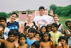 College of Nursing students travel internationally to promote health, seen here in Chulucanas, Peru, 2003.