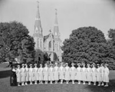 Students in front of St. Thomas of Villanova Church. October 1957.