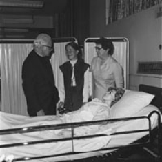 President John M. Driscoll, OSA and Dean Dorothy Marlow with nursing student in new lab in St. Mary Hall. 1975.