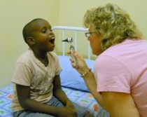 Dr. Elizabeth Blunt examines a boy at St. Theresa's Home for Children