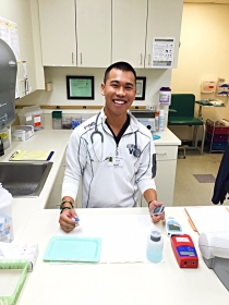Male nurse at counter