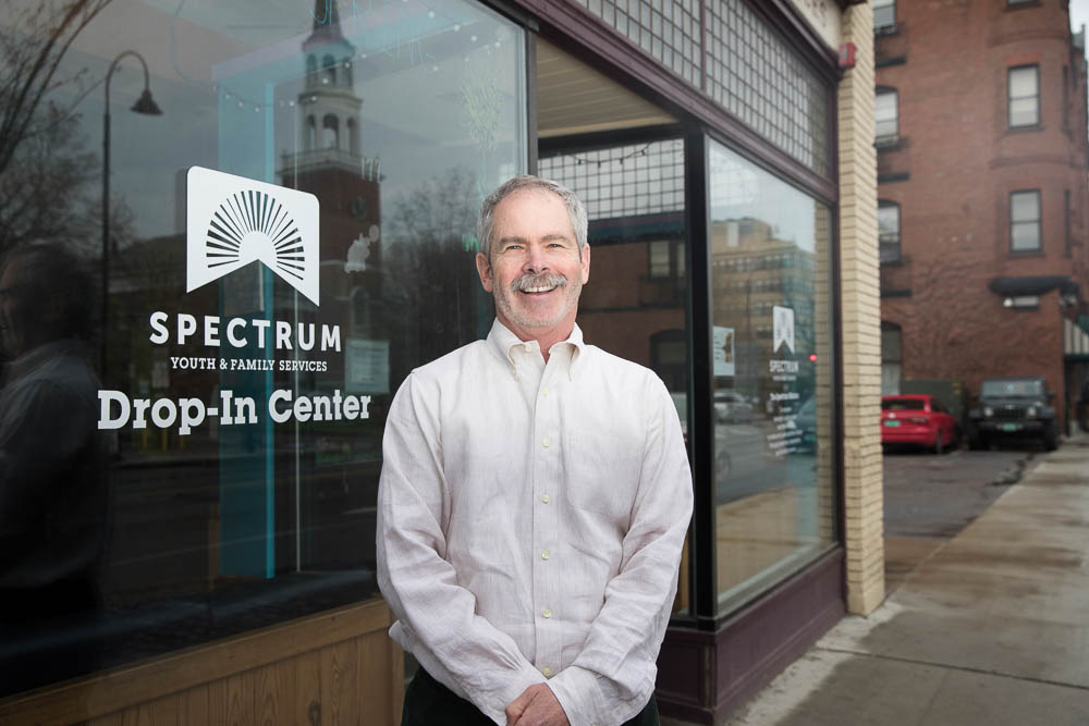 Mark Redmond standing outside a storefront of Spectrum.