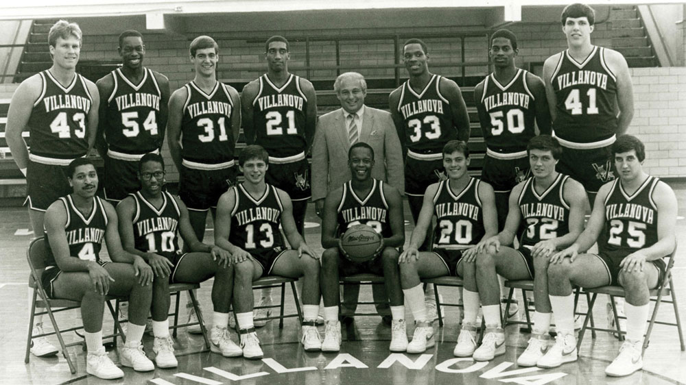 Black and White image of Rollie Massimino standing with his team