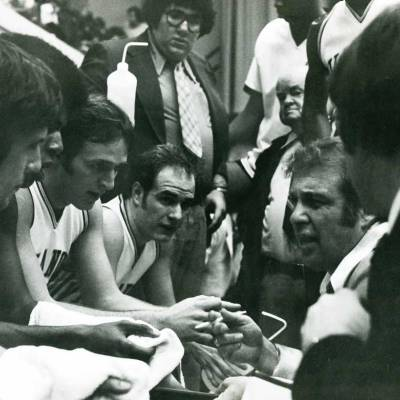 Black and White image of Coach Massimino in huddle with his team