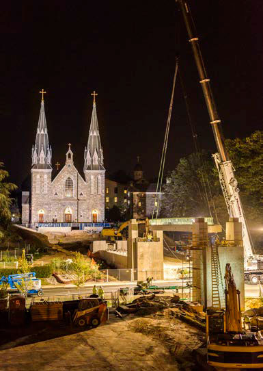 Nighttime view of the pedestrian bridge in front of St. Thomas of Villanova Church